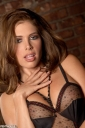Erika Jordan Stripteasing in Stockings