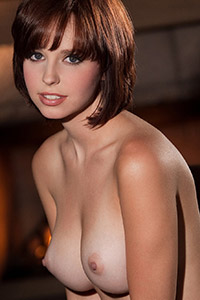 Hayden Winters Naked in Front of a Fireplace
